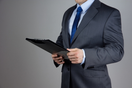 business man holding folder with documents photo