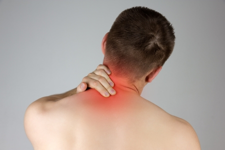 Young man with neck pain in the red zone photo