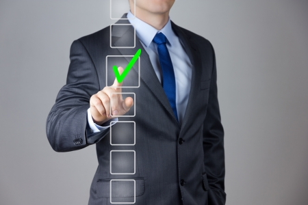 Businessman making right decision touching screen interface