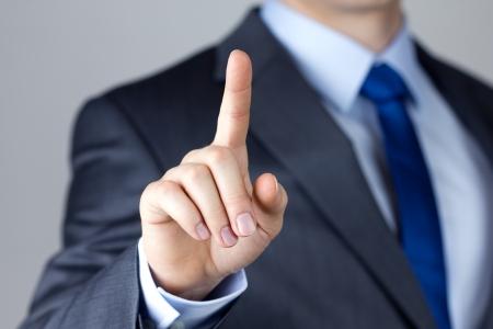 Business man touching an imaginary screen photo