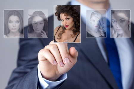 Man selecting a woman portrait image photo