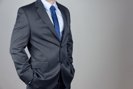 male mannequin: Man in suit in gray background Stock Photo