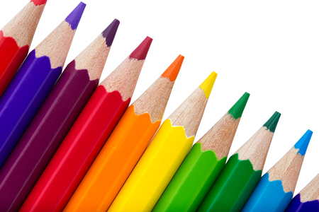 coloured pencil: Row of colourful pencils isolated over white background