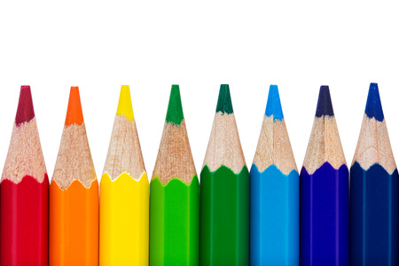 colour pencils: Row of colourful pencils isolated over white background