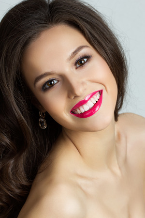 Portrait of beautiful smiling brunet woman photo