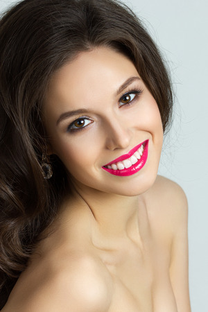 Beauty portrait of young happy brunet woman photo