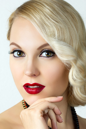 Beauty portrait of young blonde woman with retro style make-up photo
