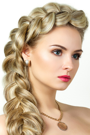Portrait of young blonde woman with fishtail hair-dress photo