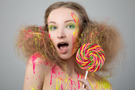 Beauty portrait of funny girl with lollipop photo