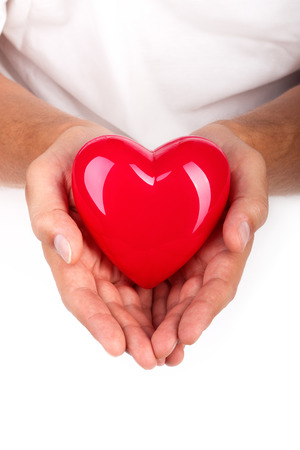 doctor holding gift: Male hands holding red heart. Health insurance or love concept