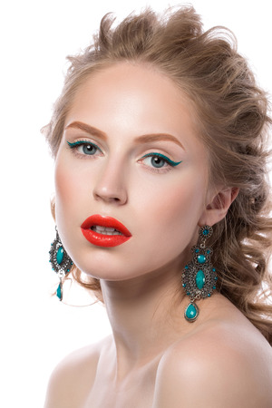 motton blue: Beauty portrait of attractive blonde young girl with curly hair with fashion makeup