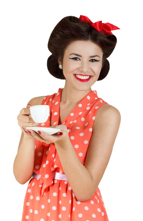 Portrait of pin-up style woman with a cup of coffee photo