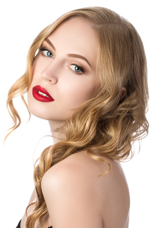 looking over shoulder: Portrait of young beautiful blonde woman looking over her shoulder Stock Photo