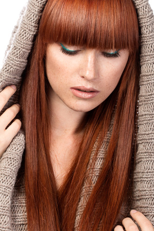 Portrait of beautiful red-haired girl with freckles wearing scarf photo