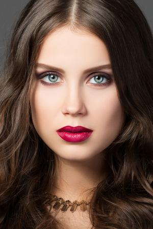 red metallic: Close-up portrait of gorgeous young brunette woman Stock Photo
