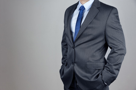 Man in suit in gray background Stock Photo