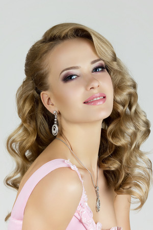 Portrait of young beautiful blonde woman photo