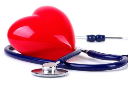 Medical stethoscope and red heart photo