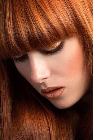 red haired: Beautiful red haired woman looking down (sensual look) Stock Photo