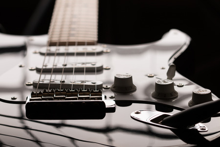 Electric guitar in dark key at unusual angle photo