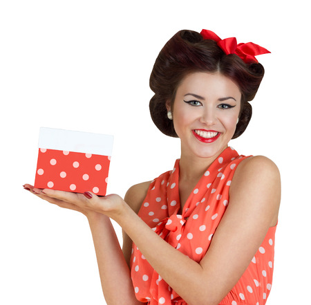 Portrait of beautiful brunette girl holding a gift box. Retro pin-up style photo