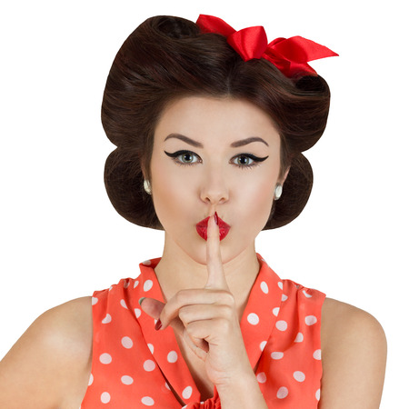 60s fashion: Vintage style portrait of woman with finger on her lips Stock Photo