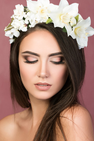 model nice: Beauty portrait of young brunette woman with white lily wreath Stock Photo