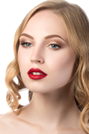Portrait of young beautiful blonde woman with red lips photo