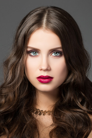 luxuriant: Beauty portrait of gorgeous young brunette woman with metallic necklace