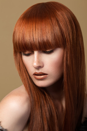 red haired woman: Red haired woman with freckles looking down (sensual look)