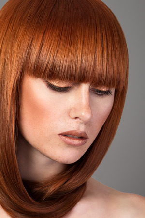 red haired: Closeup portrait of beautiful red haired woman Stock Photo