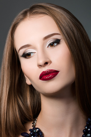 long neck: Beauty portrait of young brown-haired woman with evening make-up Stock Photo