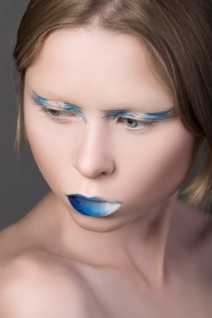Close-up portrait of young beautiful model with fancy make-up photo