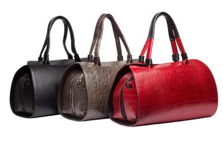 vanity bag: Set of three natural leather female purses different colour (red, brown and black) isolated on white background