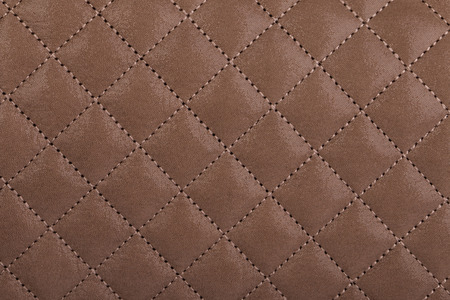 black leather texture: Light brown quilted leather background