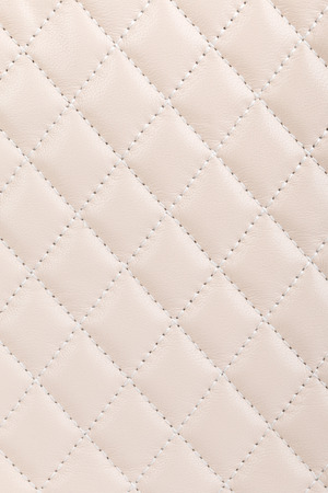 cream color: Milky white quilted leather background