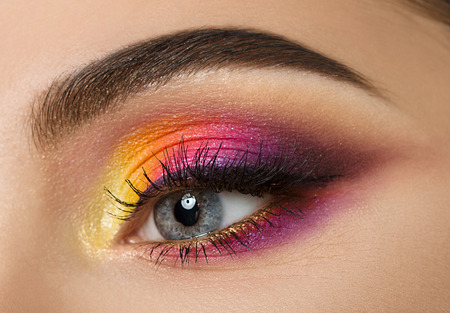 multicolored eye macro: Colse-up of woman eye with beautiful colourful makeup