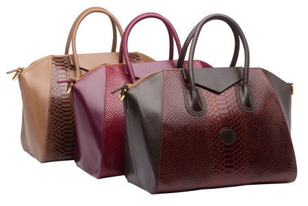 vanity bag: Set of three natural leather female purses different colour (red, brown and khaki) isolated on white background