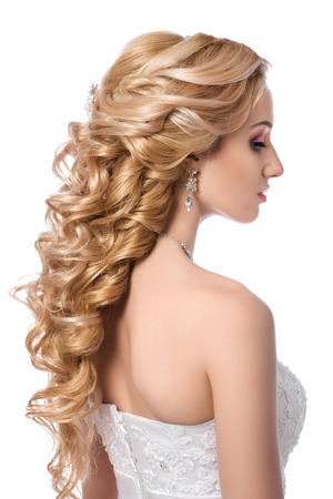 nude bride: Portrait of young beautiful bride. Wedding coiffure and make-up. Stock Photo