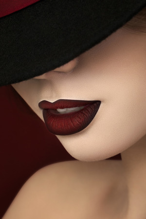 black red: Close-up portrait of young gorgeous actress with dark red lips Stock Photo