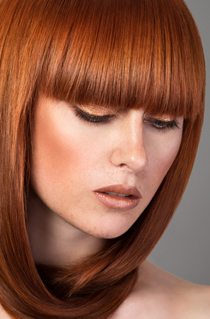 red haired woman: Closeup portrait of beautiful red haired woman Stock Photo