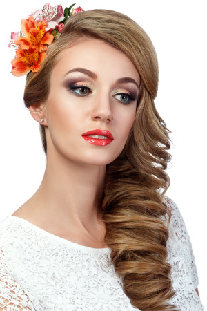 wedding portrait: Portrait of beautiful woman with flowers in her hair. Wedding coiffure and make-up.