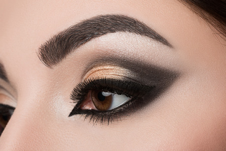 eyebrow: Close-up of woman eye with beautiful arabic makeup