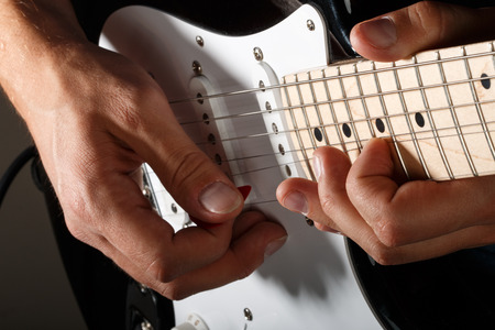 technique: Hands of man playing electric guitar closeup. Bend technique. Stock Photo