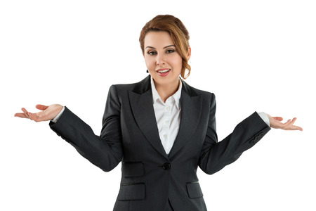 Pretty business woman holding her hands out saying that she does not know isolated over white background. No idea concept