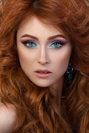 dyed hair: Close-up portrait of elegant woman with beautiful red hair. Beauty girl with perfect skin. Face make-up. Stock Photo