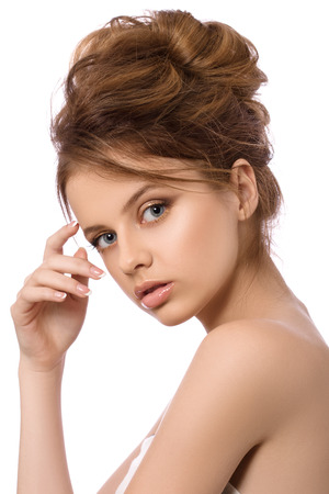 nice face: Portrait of young beautiful woman touching her face over white background, spa concept