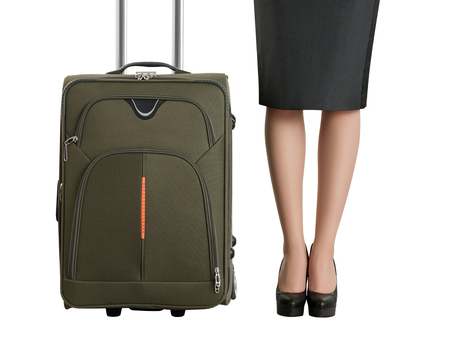 Beautiful womans legs and travel suitcase. Business travel and vacation concept