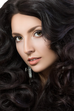 black hair: Close-up portrait of elegant woman with beautiful black hair. Beauty girl with perfect skin. Face make-up. Beauty, spa and hair care concept