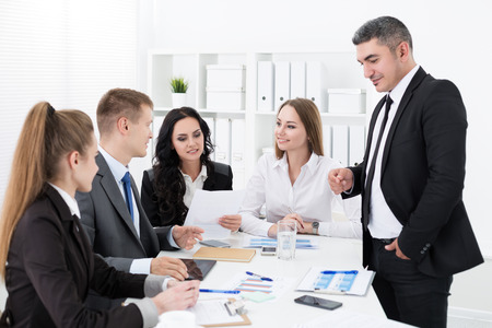 consulting team: Business people meeting in office to discuss project Stock Photo